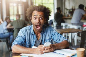 online eye exam - in-person eye exam man surprised