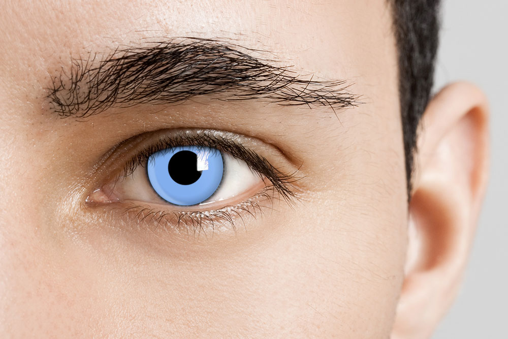 man wearing soft blue contact lenses