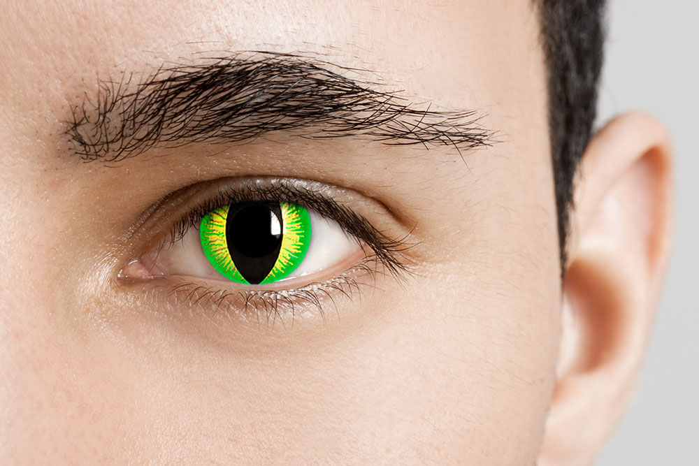 man wearing green reptile contacts