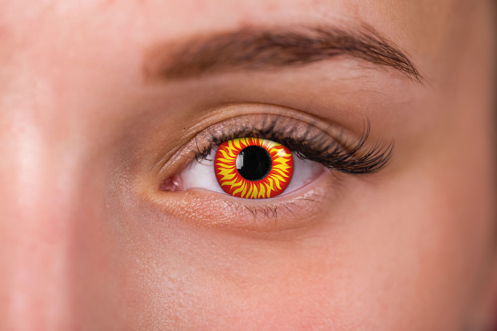 woman wearing red and yellow fire contacts
