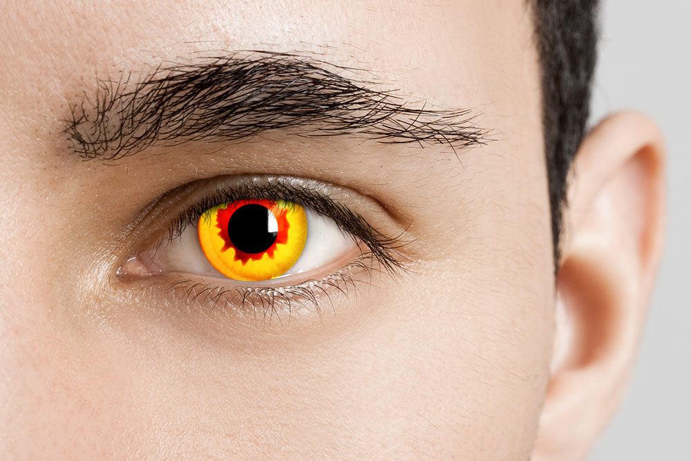 man wearing red and yellow pennywise contacts