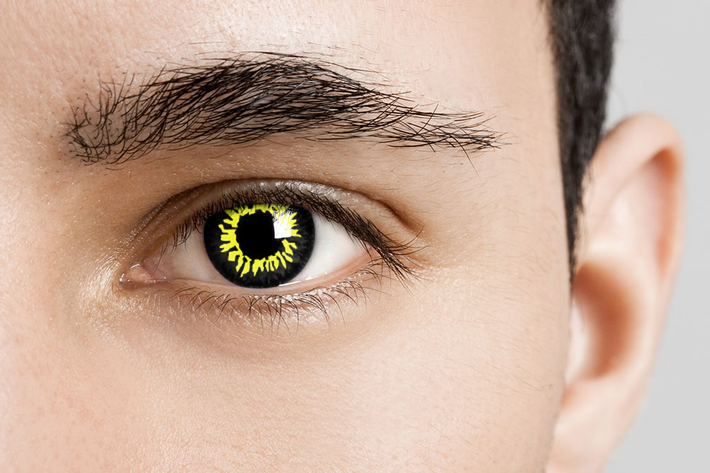 man wearing yellow and black wolf contacts
